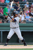 Catcher Jackson Valera (18) of the Charleston RiverDogs in a game against the Greenville Drive on Wednesday, June 11, 2014, at Fluor Field at the West End in Greenville, South Carolina. Greenville won, 6-3. (Tom Priddy/Four Seam Images)