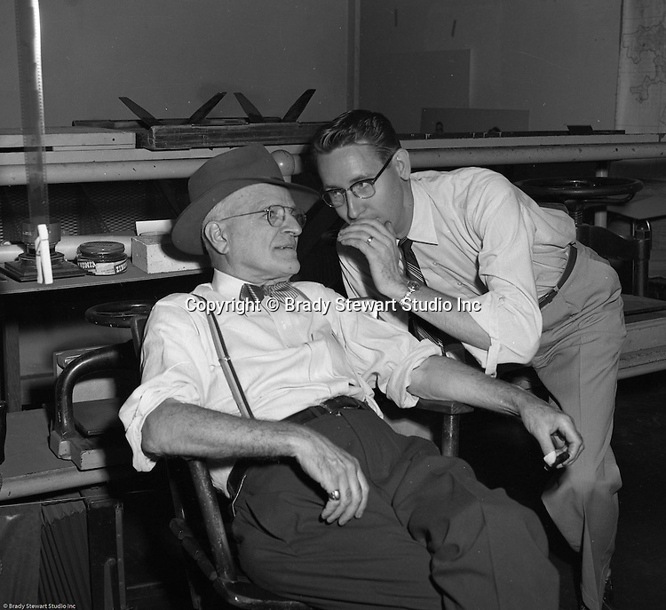 Pittsburgh PA:  Brady Stewart Sr and Dave VanDeVeer discussing important things in the office at 725 Liberty Avenue - 1955. Brady Stewart founded the business in 1912 and Dave VanDeVeer was both an excellent studio and on location photographer for Brady Stewart Studio.