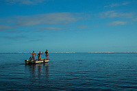 Teahupoo, Tahiti Iti, French Polynesia. Tuesday 14 August 2012. Kieren Perrow (AUS), Pat Gudauskas (USA) and Damien Hobgood (USA)heading out to Teahupoo.  The swell had backed off today to around 2' and an onshore NW wind made Teahupoo virtually unsurfable. Photo: joliphotos.com