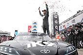 #18: Kyle Busch, Joe Gibbs Racing, Toyota Supra Extreme Concepts/iK9 celebrates in victory lane
