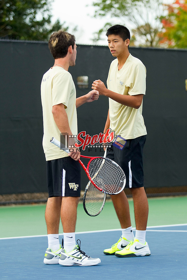 Anthony Delcore (left) and Jon Ho of the Wake Forest Demon Deacons during doubles play at the Wake Forest Tennis Center on October 12, 2012 in Winston-Salem, North Carolina.  (Brian Westerholt/Sports On Film)