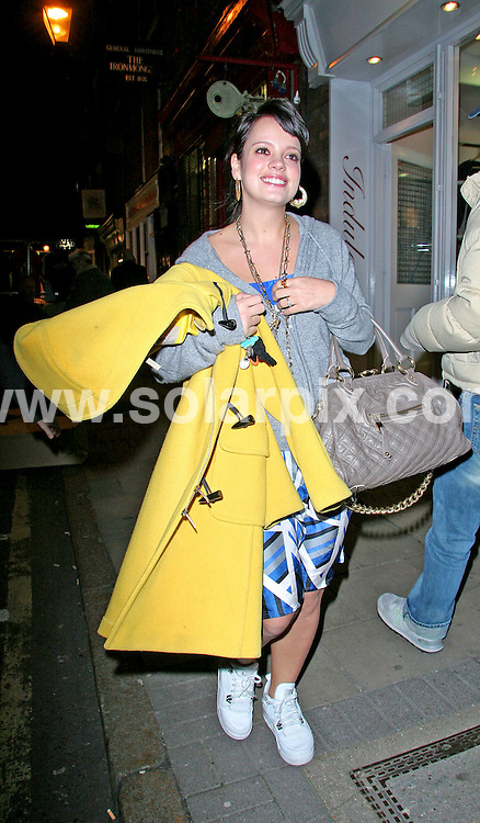 "**ALL ROUND PICTURES FROM SOLARPIX.COM**.**WORLDWIDE SYNDICATION RIGHTS**.Lily Allen signing at the ""Last Christmas I Gave You My Art"" store in Earlham Street in London on 13.12.2006.JOB REF:  3163   SSD.**MUST CREDIT SOLARPIX.COM OR DOUBLE FEE WILL BE CHARGED**"