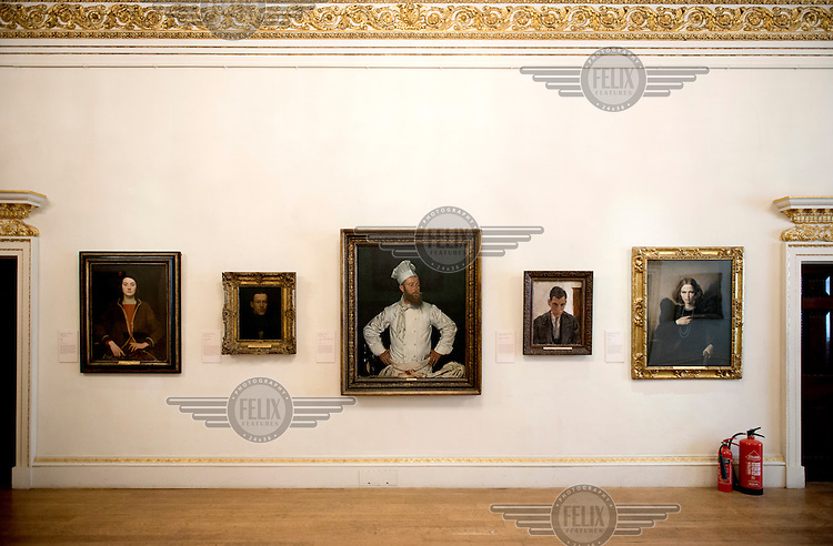 Paintings line a wall of the Reynolds Room at the Royal Academy, Piccadilly, central London. On 1 July 1858, history was made in the Reynolds Room when papers by Charles Darwin and Alfred Russel Wallace were presented to a meeting of the Linnean Society. The papers put forward the ground-breaking ideas on evolutionary biology that were later made famous by Darwin's book On the Origin of Species