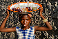 MALI, village Faragouaran , girl sells lemonade in plastic bags on the market / Markt im Dorf Faragouaran, Maedchen verkauft Lemonade in Plastiktueten auf dem Markt um Einkommen zu erzielen