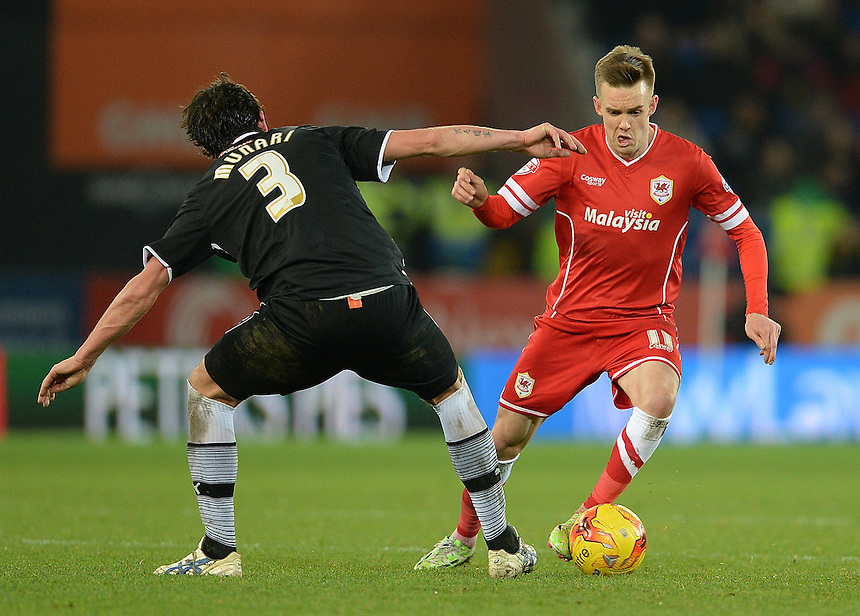 Cardiff City's Craig Noone takes on Watfords Gianni Munari  <br /> <br /> Photographer Ian Cook/CameraSport<br /> <br /> Football - The Football League Sky Bet Championship - Cardiff City v Watford - Saturday 28th December - Cardiff City Stadium - Cardiff<br /> <br /> &copy; CameraSport - 43 Linden Ave. Countesthorpe. Leicester. England. LE8 5PG - Tel: +44 (0) 116 277 4147 - admin@camerasport.com - www.camerasport.com