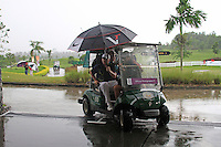 James Morrison (ENG) gets a lift back to the clubhouse as the heavens open yet again as monsoon rains fall during Saturday's storm delayed  Round 3 of the Iskandar Johor Open 2011 at the Horizon Hills Golf Resort Johor, Malaysia, 19th November 2011 (Photo Eoin Clarke/www.golffile.ie)