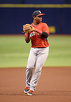 Boston Red Sox third baseman Rafael Devers (12) warmup throw to first during an Instructional League game against the Tampa Bay Rays on September 25, 2014 at the Tropicana Field in St. Petersburg, Florida.  (Mike Janes/Four Seam Images)
