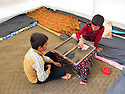 Iraq 2015 <br /> In the camp of Berseve, 2 boys playing board game in a tent  <br /> Irak 2015 <br /> Au camp de Berseve, 2 garcons jouant sous la tente a un jeu de soci&eacute;t&eacute;