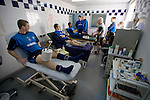 Tranmere Rovers Club Physiotherapist Les Parry, 10/03/2008. Prenton Park, League One. Tranmere Rovers' long-term injury victims Steve Davies and Chris Shuker receiving treatment on their injured knees under the supervision of club physio Les Parry in the club's treatment room as teammates queue up to be treated for fresh injuries. Les Parry has been the club physiotherapist since 1993 and recently completed 800 games with the club. At the time he was also working on completing his PhD at Liverpool John Moores University. Photo by Colin McPherson.
