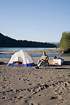 Andy Dappen relaxes at camp on Kechika River where Red River comes in.  Muskwa-Kechika Management Area.  B.C.