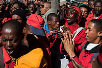 Members of the Red Ants sing as they bury Kervin Arthur Woods (46), a member of the Red Ants. He was killed during an eviction near Lenasia, South of Johannesburg. During the eviction, members of the community opened fire on the Red Ants. Woods was shot and wounded and then stabbed multiple times.<br />