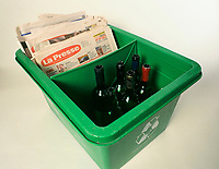 File Photo<br /> <br /> A Montreal city Recycle bin filled with newspaper and glass bottles<br /> <br /> <br /> Mandatory Credit: Photo by Pierre Roussel- Images Distribution. (©) Copyright 2004 by Pierre Roussel <br /> <br /> NOTE : scan from 2 1/4 slide