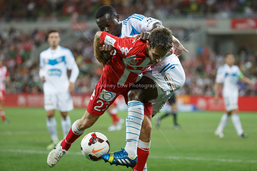 Mate DUGANDZIC of the Heart and Adama TRAORE of the Victory fight for the ball in the round 21 match between Melbourne Heart and Melbourne Victory in the Australian Hyundai A-League 2013-24 season at AAMI Park, Melbourne, Australia. Photo Sydney Low/Zumapress<br /> <br /> This image is not for sale on this web site. Please visit zumapress.com for licensing