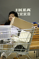 A tired shopper grabs a quick rest at the IKEA superstore in Shanghai, China. IKEA has attracted many modern Chinese consumers with its attractive designs and affordable price that targets medium income families. Having opened its largest Asian store earlier this year in Shanghai, IKEA plans to open two new stores in China next year in Beijing and Guangzhou..22-OCT-03