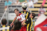 7 August 2007: FC Dallas's Clarence Goodson (left) challenges for the ball against Charleston defenders Kevin Nylen (center) and Anthony Catalano (right). FC Dallas of Major League Soccer defeated the Charleston Battery of the United Soccer League first division 2-1 after extra time in a quarterfinal match of the 2007 US Open Cup tournament at Blackbaud Stadium in Charleston, SC...