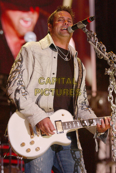 MONTGOMERY GENTRY.2007 CMA Music Festival held at LP Field, Nashville, Tennessee , USA, 08 June 2007..country live on stage concert half length white guitar .CAP/ADM/LF.©Laura Farr/AdMedia/Capital Pictures.