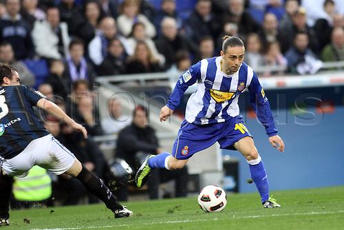 26.02.2011 Spanish La Liga from the Cornella-El Prat stadium. Espanyol v Real Sociedad..Sergio Garcia in action near Mikel Gonzalez (L)