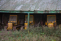 Vintage International crawlers stored in an old barn<br /> &copy;Tim Scrivener Photographer 07850 303986<br />      ....Covering Agriculture In The UK....