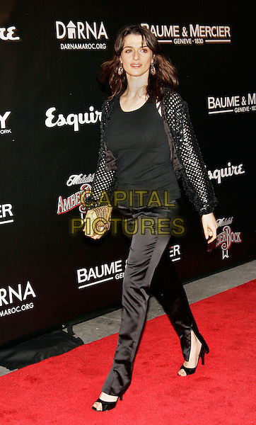 RACHEL WEISZ.Esquire and Jacquetta Wheeler's 212 Society Host Celeb Studded Benefit at Esquire Downtown at Astor Place, New York, NY..November 14th, 2005.Photo: Jackson Lee/Admedia/Capital Pictures.Ref: JL/ADM.full length gold clutch purse black trousers top cardigan.www.capitalpictures.com.sales@capitalpictures.com.© Capital Pictures.