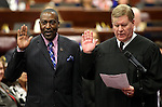 Nevada Assemblyman Tyrone Thompson, D-North Las Vegas, left, receives the oath of office from Supreme Court Associate Chief Justice Mark Gibbons at the Legislative Building in Carson City, Nev., on Wednesday, April 24, 2013. Thompson was selected by the Clark County Commission to replace Assemblyman Steven Brooks who was expelled in March. (AP Photo/Cathleen Allison)