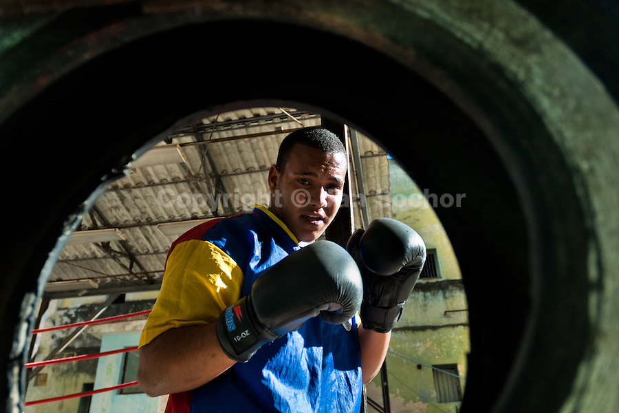 A Cuban boxer trains punches at Rafael Trejo boxing gym, an outdoor sport facility in the Old Havana, Cuba, 5 February 2010. During the last 30 years Cuba has produced more World Champions and Olympic gold medallists in amateur boxing than any other country. Many famous fighters, who came out of Cuba, were training at Rafael Trejo boxing gym in their youth. This run down open air facility in the Old Havana is a place of learning and mastering the art of boxing by the old school style. Boys begin their training very young. As sports are given a high political priority in Cuba, all children are systematically encouraged to develop their skills. Those who succeed will become heroes of Cuban society.