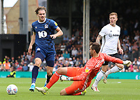 Blackburn Rovers' Sam Gallagher is tackled by Fulham's Marcus Bettinelli<br /> <br /> Photographer David Shipman/CameraSport<br /> <br /> The EFL Sky Bet Championship - Fulham v Blackburn Rovers - Saturday 10th August 2019 - Craven Cottage - London<br /> <br /> World Copyright © 2019 CameraSport. All rights reserved. 43 Linden Ave. Countesthorpe. Leicester. England. LE8 5PG - Tel: +44 (0) 116 277 4147 - admin@camerasport.com - www.camerasport.com