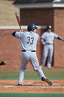 Aaron Wright (33) of the UNCG Spartans at bat against the High Point Panthers at Willard Stadium on February 14, 2015 in High Point, North Carolina.  The Panthers defeated the Spartans 12-2.  (Brian Westerholt/Four Seam Images)