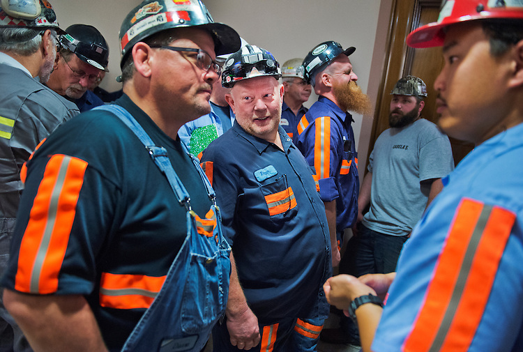 "UNITED STATES - JUNE 18: From left, coal miners Duane Thaxton, left, of W.Va., Roger Workman of Ky., and, David Decker, far right, of W.Va., wait for the start Clean Air and Nuclear Safety Subcommittee hearing in Dirksen of the Senate Environment and Public Works Committee, June 18, 2014, titled ""Climate Change: The Need to Act Now."" (Photo By Tom Williams/CQ Roll Call)"