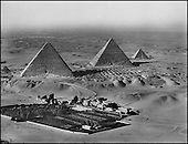 The three great , Kheops, Kephren, Mykerinos (IVth dynasty, around 2,600 B.C.) This aerial view of the great pyramids was made for the first time in 1924, after an initial failed manual attempt by the American Henry Breasted in 1921. A photographer for the Royal Air Force attached a camera onto the fuselage of his Bristol Fighter MK II, the Royal Air Force's work horse during all of World War I. He was this able to calculate his frames from the top of the Mena House Hotel, which appears in the images with its gardens, in the middle of the Giza oasis in the then still intact desert to the west of the Giza plateau. To the north of the pyramids, on the cliffs, stands the necropolis of aristocratic members of the IVth dynasty, still barely explored by archeologists today...ROYAL AIR FORCE/COLLECTION PATRICK CHAPUIS-PHILIPPE FLANDRIN