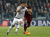 Juventus' Sami Khedira, left, is challenged by Roma's William Vainqueur during the Italian Serie A football match between Juventus and Roma at Juventus Stadium.