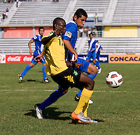 Andre Lewis (11) of Jamaica fights for the ball with Cristian Jimenez (6) of Guatemala during the group stage of the CONCACAF Men's Under 17 Championship at Catherine Hall Stadium in Montego Bay, Jamaica. Jamaica defeated Guatemala, 1-0.