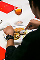 A customer enjoys eating a Fresh Mac burger with fork and knife as a part of McDonald's special dinner during a ''Restaurant M'' event in the posh Roppongi Hills area on July 27, 2015, Tokyo, Japan. 20 chosen diners (from 8,300 applications) ate a special multi-course dinner created by the celebrity chef using ingredients from the restaurant chain's regular menu. The special one-night only event was organized to celebrate the launch of its new summer menu ''Fresh Mac,'' which features fresh vegetables. The five-course meal served on a white tablecloth with plates and proper cutlery included a Vichyssoise en Pommes de terre de McDonald, Mousse au Poivron Rouge, Salade en Gelee aux Legumes de McDonald, Cinq Pinchos des McDonald Patties avec leur Sauces, a choice of main dish including the Fresh Mac Bacon Lettuce Burger, and a McFlurry Mixed Berry Oreo dessert with a Premium Roast Coffee. (Photo by Rodrigo Reyes Marin/AFLO)