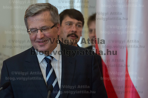 Bronislaw Komorowski (L) president of Poland and his Hungarian counterpart Janos Ader (R) talk during a press conference in Budapest, Hungary on March 21, 2014. ATTILA VOLGYI