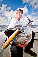 Landing Bluefin Tuna in excess of 100lb is always a challenging task, even for a young man in his 20s plenty of strength. The grin on his face shows how rewarding has been such accomplishment