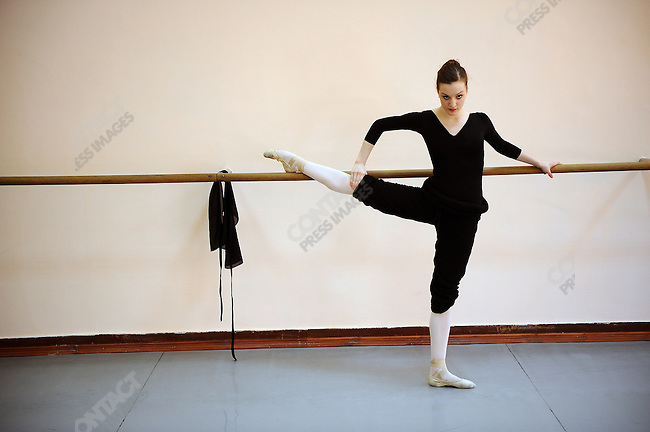 Joy Womack, an American student at the Moscow State Academy of Choreography, the main school feeding dancers to the Bolshoi Ballet and one of the top ballet schools in the world, warmed up at the beginning of a class. Moscow, Russia, March 10, 2010