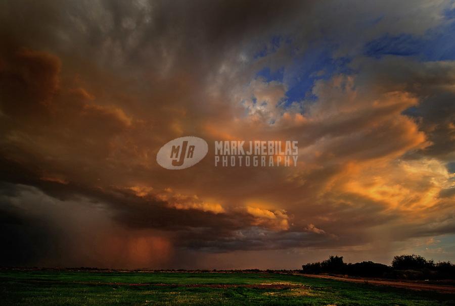 desert weather storm chaser chasing clouds sky Arizona sunset red orange farm farmland field rain monsoon thunderstorm
