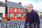 Cllr: Michael Cahill standing by the derelict Glendale building in Glenbeigh village, that will be demolished and three social housing units put in its place