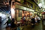 Customers enjoy the outside ambience of a  restaurant inside the old market area of Shimokitazawa, Setagaya Ward, Tokyo, Japan..Photographer: Robert Gilhooly