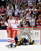 Colby Cohen (BU - 25) and Vinny Saponari (BU - 27) celebrates Cohen's first goal of the night which made it 2-0 BU in the first period. - The Boston University Terriers defeated the Merrimack College Warriors 6-4 (EN) on Saturday, January 16, 2010, at Agganis Arena in Boston, Massachusetts.