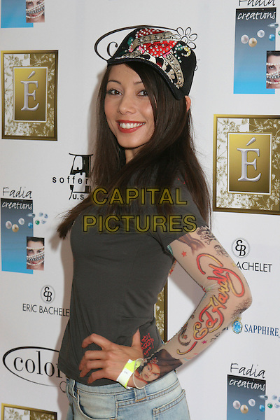 RACHEL GRANT.2nd Annual Make the Discovery Oscar Retreat,  West Hollywood, California, USA..March 3rd, 2006.Photo: Byron Purvis/AdMedia/Capital Pictures.Ref: BP/ADM.half length baseball cap hat sleeves print.www.capitalpictures.com.sales@capitalpictures.com.© Capital Pictures.