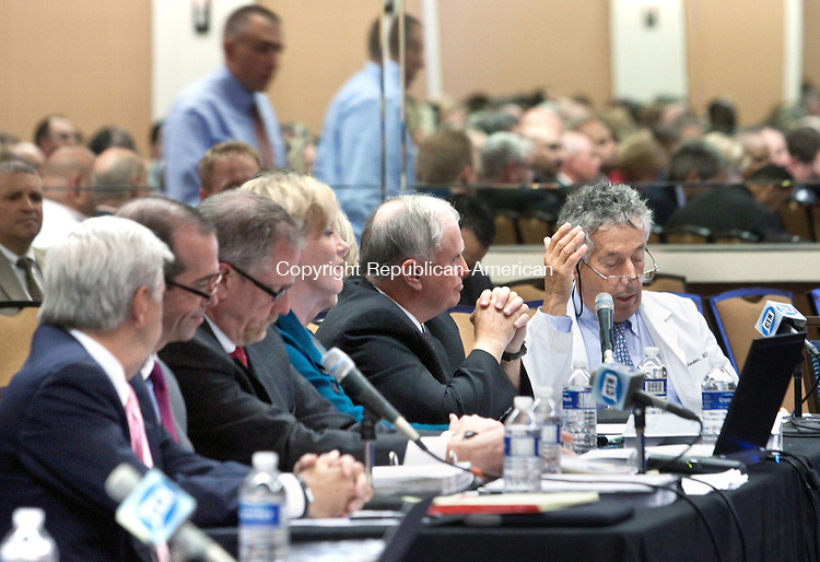 WATERBURY- OCTOBER 15 2014 101514DA08- Pulmonologist in Waterbury, Dr. Carl Sherter, also served as Chief of Waterbury Hospital Medical Staff,  speaks during a public hearing on the proposal by Waterbury Hospital and Tenet Healthcare Corp.<br /> Darlene Douty Republican American