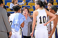 25 February 2012:  FIU Head Coach Cindy Russo speaks with players during a break in the action in the first half as the FIU Golden Panthers defeated the University of South Alabama Jaguars, 58-55 (OT), at the U.S. Century Bank Arena in Miami, Florida.