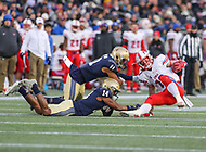 Annapolis, MD - November 11, 2017: Southern Methodist Mustangs wide receiver Trey Quinn (18) gets tackled by serveral Navy Midshipmen defenders during the game between SMU and Navy at  Navy-Marine Corps Memorial Stadium in Annapolis, MD.   (Photo by Elliott Brown/Media Images International)