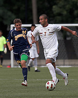 Boston College forward/midfielder Amit Aburmad (7) brings the ball forward as Quinnipiac University defender William Cavallo (24) closes. Boston College defeated Quinnipiac, 5-0, at Newton Soccer Field, September 1, 2011.