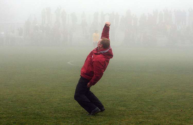 Matt Potter, Washington State University Head Women's Soccer Coach, celebrates in the fog after his Cougars beat Arizona State in double overtime in their Pac-10 conference match in Pullman, Washington, on November 9, 2008.  The Cougars needed a victory for a chance at an NCAA bid and they finally prevailed, 1-0, on a dramatic goal by Elysse Van Leer in the second overtime.