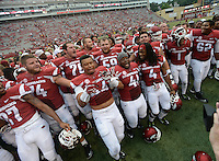 STAFF PHOTO ANTHONY REYES &bull; @NWATONYR<br /> Members of the Razorbacks celebrate a win against Nicholls State in the fourth quarter Saturday, Sept. 6, 2014 at Razorback Stadium in Fayetteville. The Hogs won 73-7.