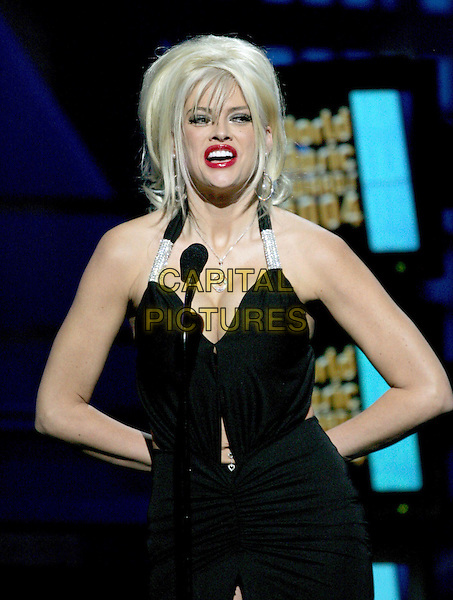 ANNA NICOLE SMITH.Is a presenter at the 15th Annual World Music Awards held at The Thomas & Mack Center in Las Vegas, Nevada, USA, September 15th 2004..half length back halterneck dress diamante strap red lipstick cleavage belly button peircing jewellery silver heart.Ref: DVS.www.capitalpictures.com.sales@capitalpictures.com.©Capital Pictures.