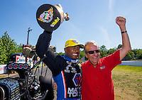Jun 7, 2015; Englishtown, NJ, USA; NHRA top fuel driver Antron Brown (left) celebrates with team owner Don Schumacher after winning the Summernationals at Old Bridge Township Raceway Park. Mandatory Credit: Mark J. Rebilas-
