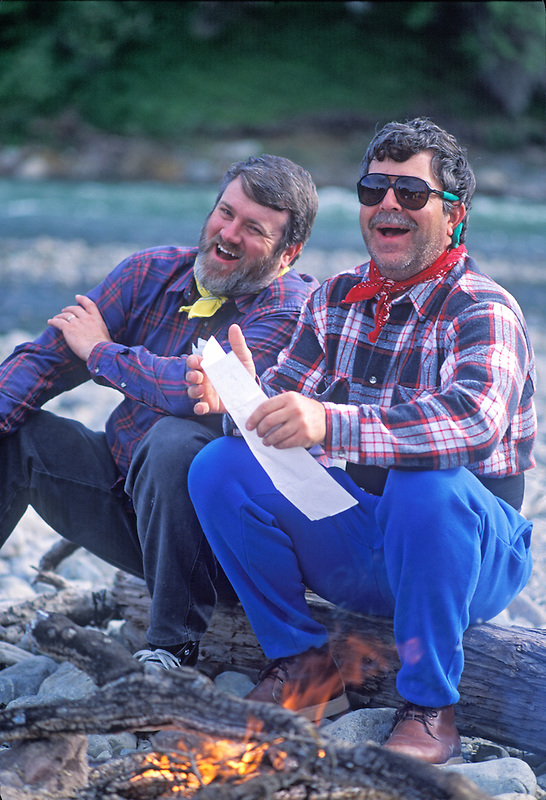 Campers checking map. Talachulitna River, Alaska.