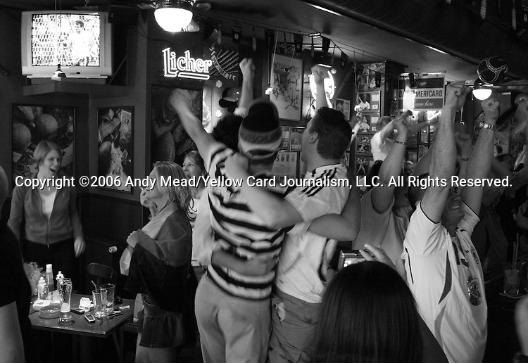 30 June 2006: Germany fans celebrate during the penalty kick shootout at a sports bar in Frankfurt, site of several games during the FIFA 2006 World Cup. Germany defeated Argentina in a Quarterfinal game played in Berlin.